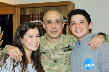 Sgt. First Class Larry Ostroff and his children, Jessica O. and Zachary O. (Photo by Ben W.)